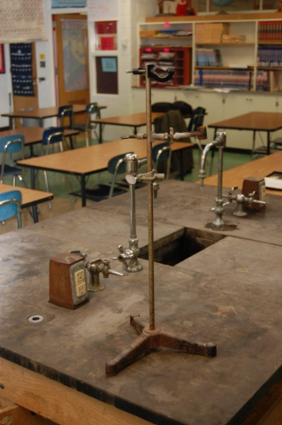 View of table top with rusted test tube holder